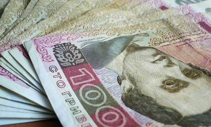 МВФ вимагає, щоб Україна знизила курс гривні
